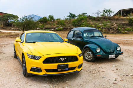 HIERVE EL AGUA, MEXICO - MAY 26, 2017: Motor cars Ford Mustang and Volkswagen Beetle at the countryside. Editorial