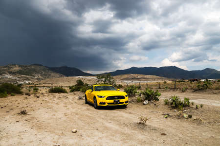 sportcar: OAXACA, MEXICO - MAY 26, 2017: Yellow supercar Ford Mustang at the countryside. Editorial