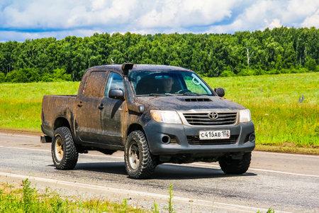 CHELYABINSK REGION, RUSSIA - JULY 10, 2017: Pickup truck Toyota Hilux at the interurban road. Editorial