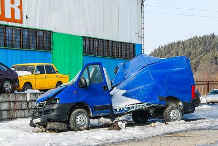 YURYUZAN, RUSSIA - MARCH 10, 2012: Crashed cargo van Fiat Ducato in the town street.