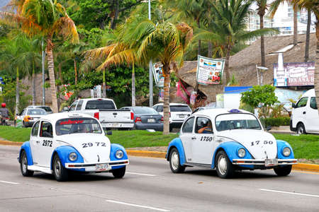 Acapulco, Mexico - May 30, 2017: Taxi cars Volkswagen Beetle in the city street.