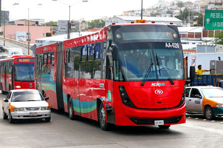Acapulco, Mexico - May 29, 2017: Articulated city bus Dina Brighter in the city street.