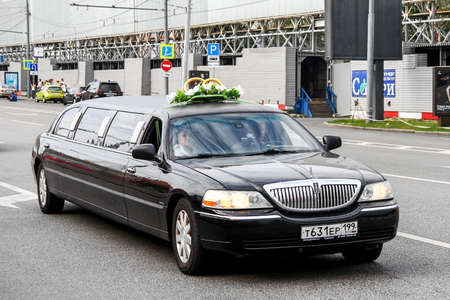 MOSCOW, RUSSIA - JULY 7, 2012: Black limousine Lincoln Town Car in the city street.