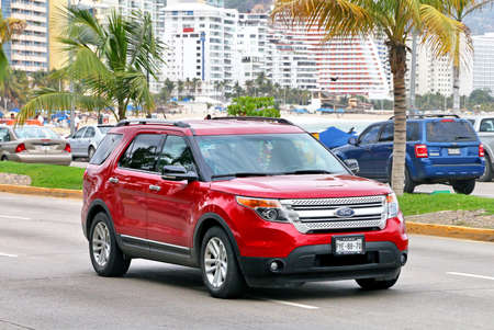 Acapulco, Mexico - May 30, 2017: Red motor car Ford Explorer in the city street.