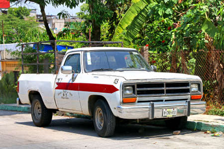 Palenque, Mexico - May 23, 2017: White pickup truck Dodge Ram in the city street. Editorial