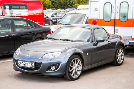 Moscow, Russia - September 29, 2012: Grey motor car Mazda MX-5 in the city street.