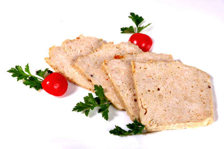 Sliced ground meat with cherry tomatoes isolated over white background