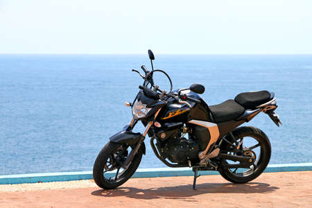 Acapulco, Mexico - May 31, 2017: Black bike Yamaha FZ ver 2.0 at the background of the Pacific ocean.