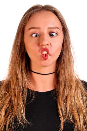 Foolish teenager girl isolated over white background