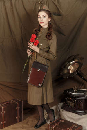 Pretty young girl in a Soviet military uniform Stock fotó
