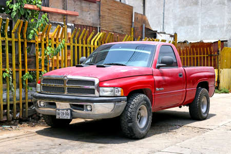 Oaxaca, Mexico - May 25, 2017: Red pickup truck Dodge Ram 1500 in the city street. Redakční