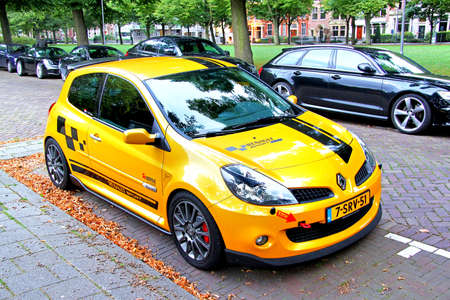 Rotterdam, the Netherlands - August 9, 2014: Motor car Renault Clio in the city street.