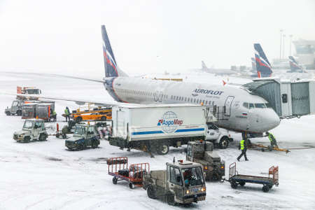 Moscow, Russia - February 3, 2018: Aeroflot Boeing 737 is boarded in the Sheremetyevo International Airport during a heavy snowfall. Editorial