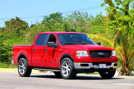Quintana Roo, Mexico - May 16, 2017: Red pickup truck Ford Lobo at the interurban road.