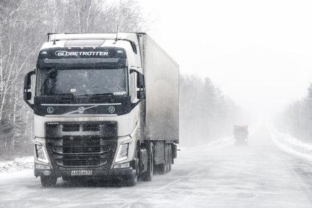 Chelyabinsk region, Russia - February 10, 2018: Semi-trailer truck Volvo FH at the interurban road during a heavy blizzard.