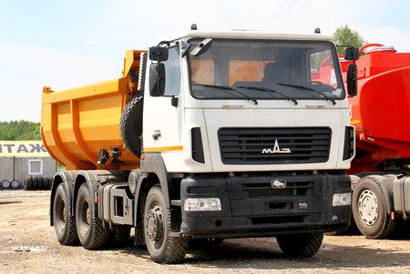 Chelyabinsk region, Russia - Brand new dump truck MAZ 6501 at the interurban road.