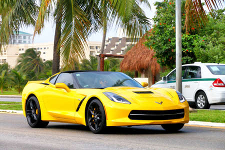 Cancun, Mexico - June 4, 2017: Yellow supercar Chevrolet Corvette in the city street. 報道画像