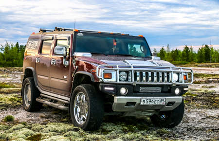 Novyy Urengoy, Russia - June 26, 2017: Off-road motor car Hummer H2 at the countryside.