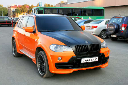 Ufa, Russia - September 23, 2008: Black and orange SUV BMW (E70) X5 in the city street.
