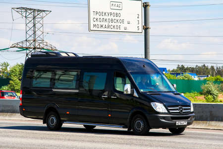 Moscow, Russia - June 2, 2012: Passenger van Mercedes-Benz Sprinter at the interurban road. 報道画像