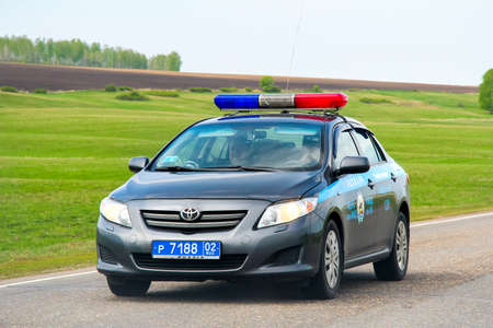 Bashkortostan, Russia - May 8, 2012: Police car Toyota Corolla at the interurban road.