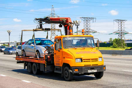 Moscow, Russia - June 2, 2012: Orange tow truck ZIL 5301 Bychok at the interurban freeway.