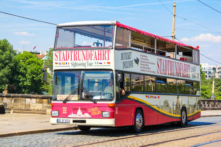 Dresden, Germany - July 20, 2014: Red city sightseeing bus MAN SD202 in the city street.