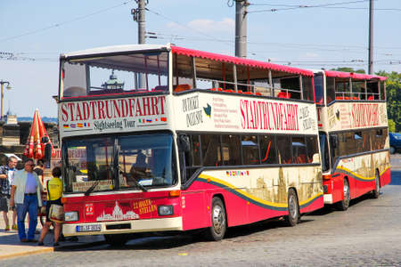 Dresden, Germany - July 20, 2014: Red city sightseeing bus MAN SD202 in the city street. Editorial