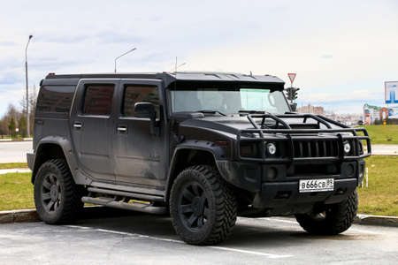 Novyy Urengoy, Russia - June 14, 2018: Black off-road vehicle Hummer H2 in the city street.