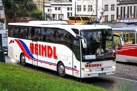 Prague, Czech Republic - July 21, 2014: White touristic coach bus Mercedes-Benz Turk O350-15RHD Tourismo in the city street.