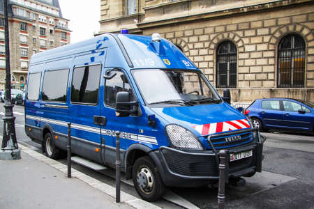 Paris, France - August 8, 2014: Gendarmerie van Iveco Daily in the city street.