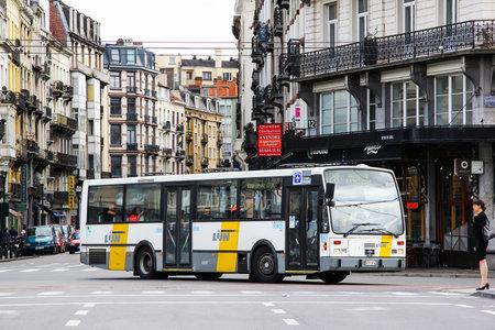 Brussels, Belgium - August 9, 2014: Urban bus Van Hool A600 of the De Lijn company the city street. 에디토리얼