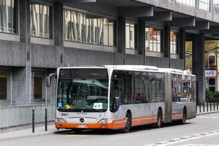 Brussels, Belgium - August 9, 2014: Articulated urban bus Mercedes-Benz O530 Citaro G in the city street.