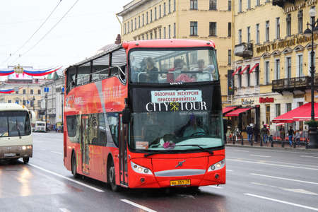Saint Petersburg, Russia - May 25, 2013: Red city sightseeing bus UNVI Urbis in the city street.