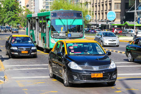 Santiago, Chile - November 13, 2015: Taxi car Nissan Tiida in the city street.