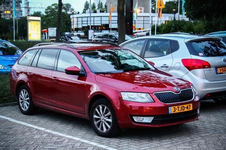 Rotterdam, Netherlands - August 9, 2014: Motor car Skoda Octavia in the city street.
