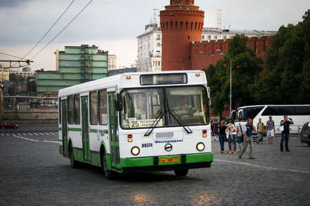 Moscow, Russia - July 9, 2011: White and green city bus LIAZ 5256 in the city street near the Kremlin Wall. 에디토리얼