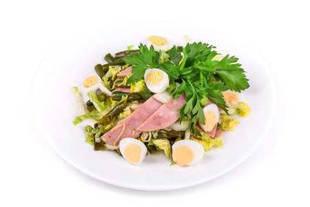 Salad of ham, green beans, lettuce and eggs on a white plate isolated over white 版權商用圖片