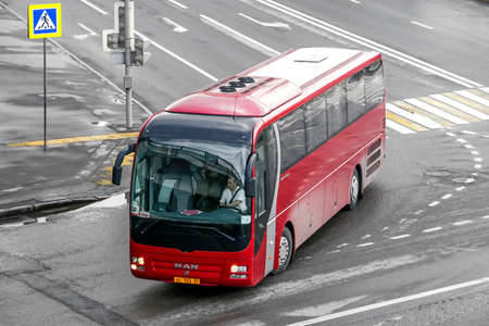 Moscow, Russia - May 2, 2018: Touristic coach bus MAN R07 Lions Coach in the city street. 에디토리얼