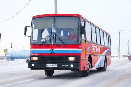 Pangody, Russia - February 4, 2013: Intercity coach bus TAM 190A110 in the city street. 에디토리얼