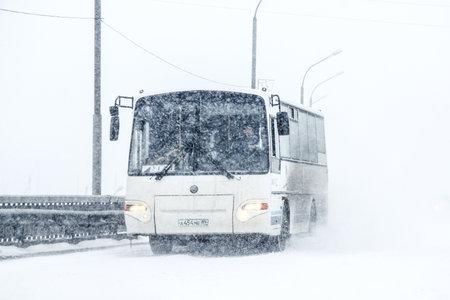 Novyy Urengoy, Russia - May 5, 2014: Intercity coach bus KAVZ 4235 Avrora during a heavy northern blizzard. 에디토리얼
