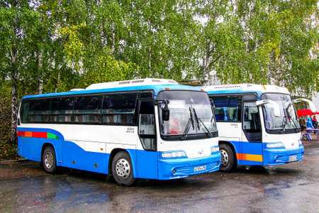 Ufa, Russia - September 29, 2011: Small intercity buses Daewoo BH090 Royal Star in the city street.
