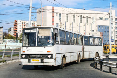 Chelyabinsk, Russia - September 18, 2009: White articulated bus Ikarus 280 in the city street. 에디토리얼