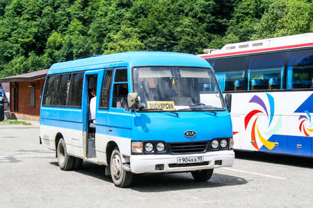 Sochi, Russia - July 21, 2009: Touristic coach bus Kia Combi at the countryside.