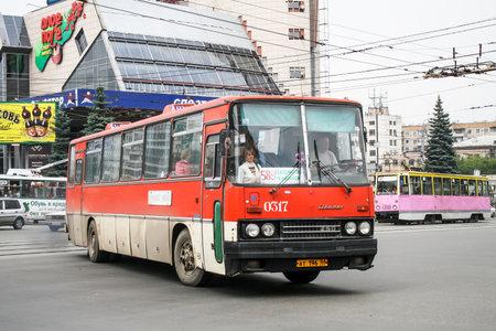 Chelyabinsk, Russia - July 2, 2008: Red interurban bus Ikarus 250 in the city street.