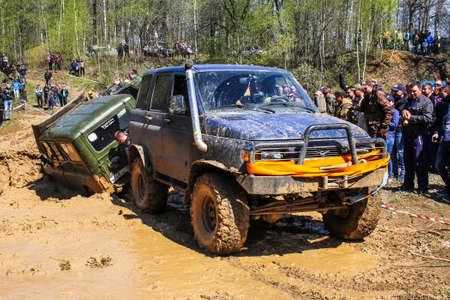 Asha, Russia - May 8, 2017: Off-road car UAZ 3160 rescues an UAZ 3151 taken part in the local trophy competition.