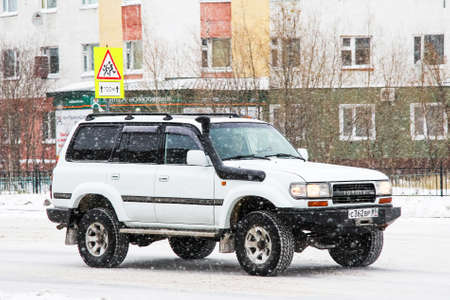 Novyy Urengoy, Russia - October 20, 2012: Offroad vehicle Toyota Land Cruiser 80 in the city street.