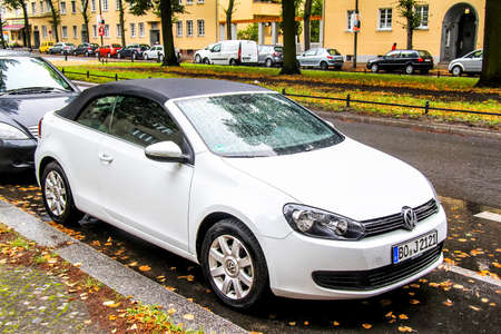 Berlin, Germany - September 10, 2013: White motor car Volkswagen Golf in the city street. Redakční