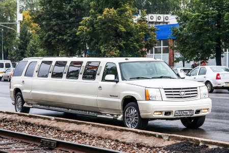 Ufa, Russia - September 18, 2011: White limousine Cadillac Escalade in the city street. 에디토리얼