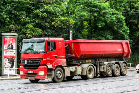 Prague, Czech Republic - July 21, 2014: Red dump truck Mercedes-Benz Axor 1843 in the city street.
